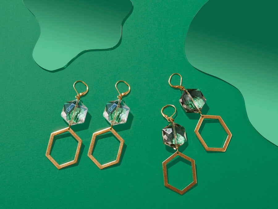 Under the Moonlight Earrings by MoonRox Jewellery & Accessories feature a combination of shiny crystal and brass polygons. Choose from two colours. Made in Toronto, Canada.