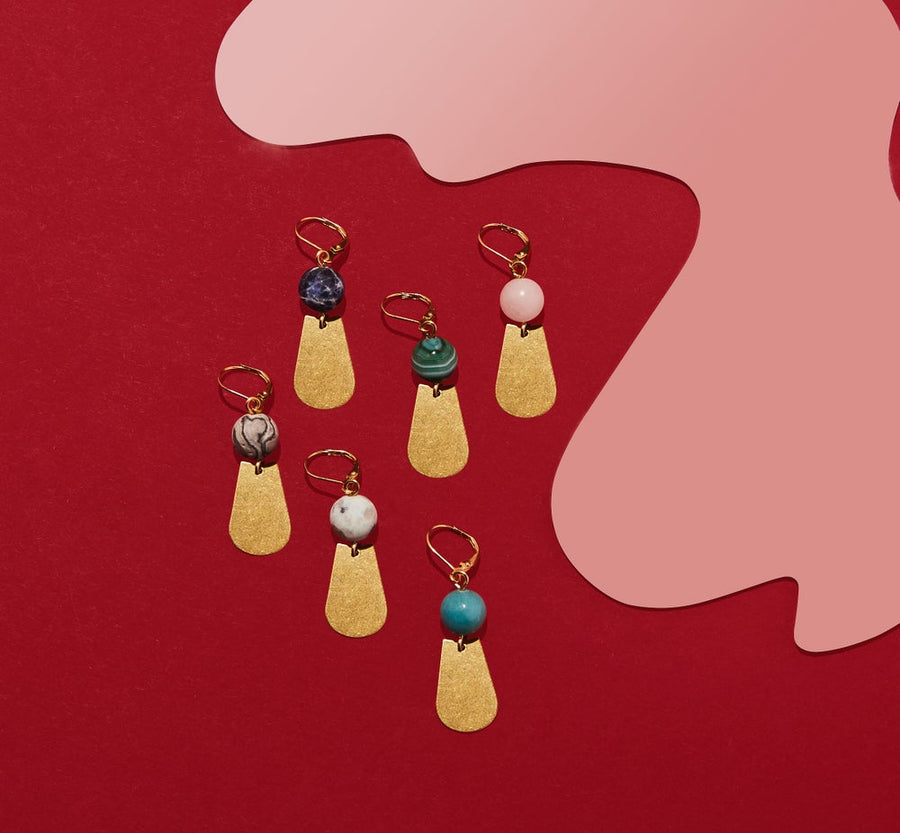 Veritas Earrings feature semi-precious stones that are hand wired to brass charms. Made in Toronto, Canada by MoonRox Jewellery & Accessories.