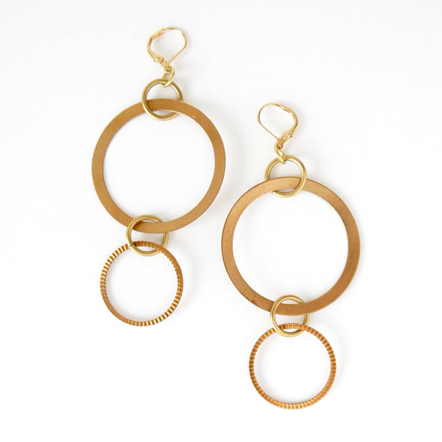 Whirlwind Earrings are large statement earrings with a mix of brass circles and loops. Made by MoonRox in Toronto, Canada.