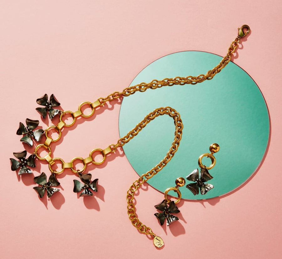 Wildflower Necklace by MoonRox Jewellery & Accessories is a floral necklace combining mixed metals and vintage components. Shown with the matching Wildflower Stud Earrings.