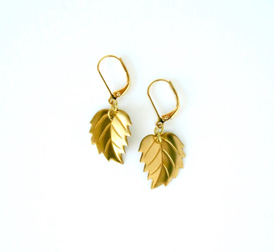 Leaf Earrings by MoonRox Jewellery & Accessories feature serrated brass leaves hung from lever back ear wires.