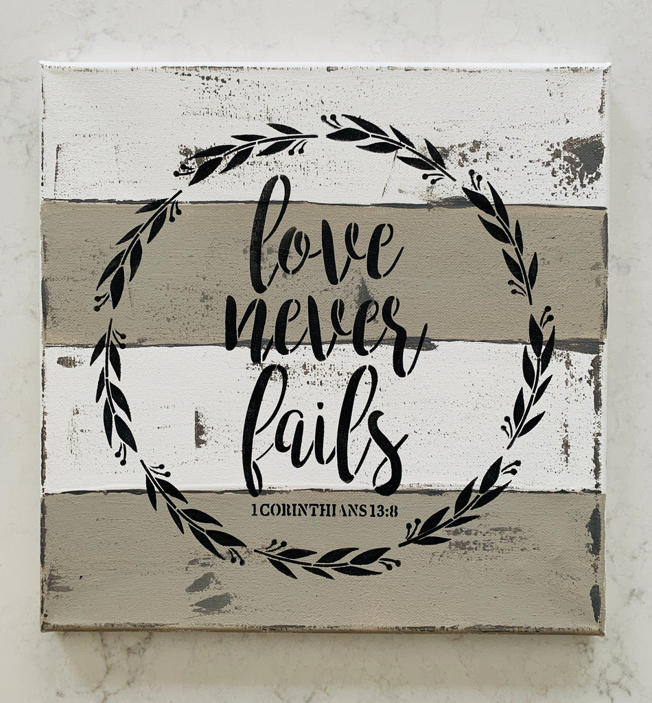 love never fails painted canvas