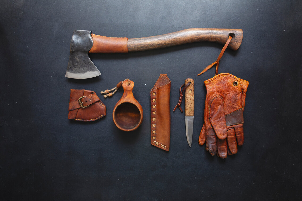 A hatchet other bushcraft tools