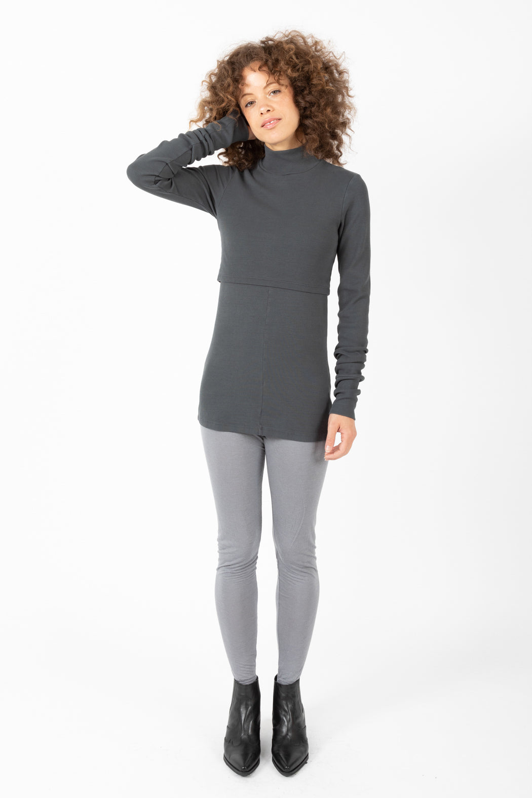 A sweater alternative in organic cotton, the Layered Mock Neck appears as two layers, the crop top overlay emphasizes your waist while the double layers of textile adds core warmth.