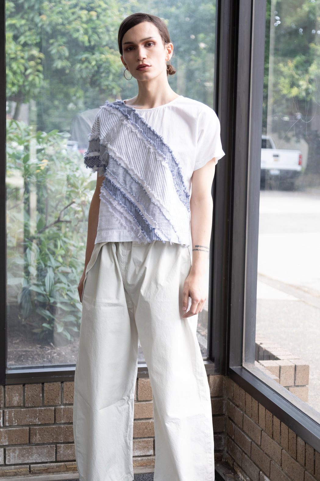 Photo of white organic cotton boxy tee
