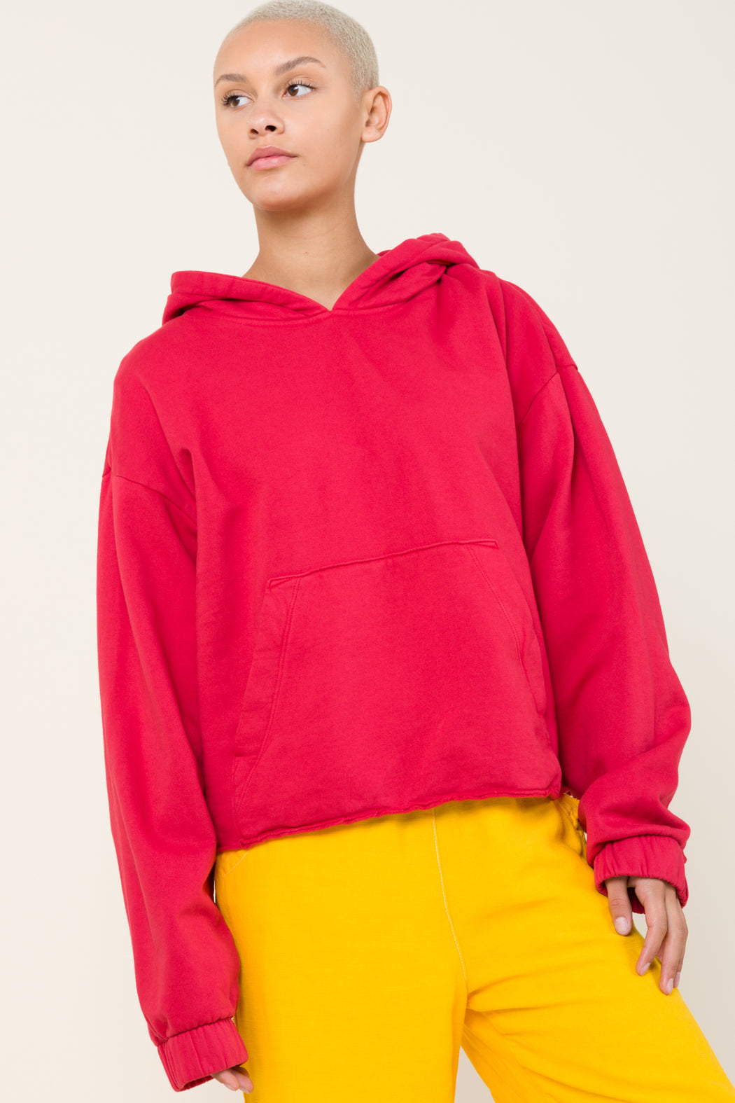 Our Band Together hoodie in Lipstick is an oversized pullover hoodie with deconstructed hem and elasticated cuffs. Evocative of the 70's era home sewing, the smaller hood and oversized fit update this style.