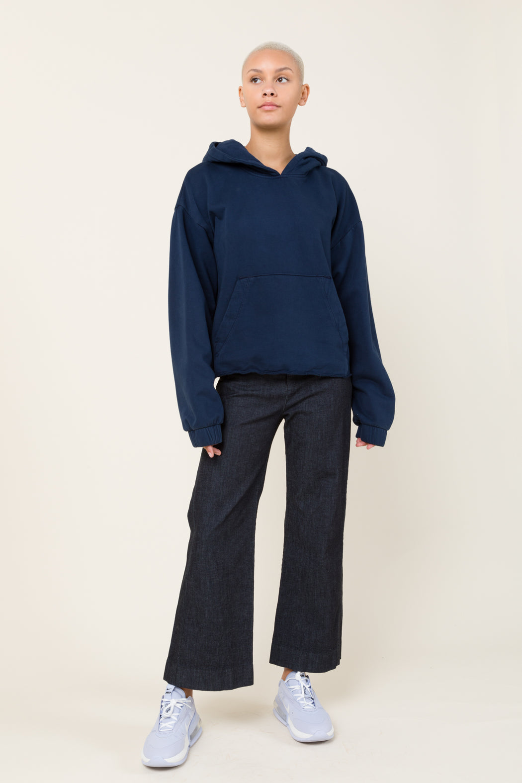 Our Band Together hoodie in Midnight is an oversized pullover hoodie with deconstructed hem and elasticated cuffs. Evocative of the 70's era home sewing, the smaller hood and oversized fit update this style.