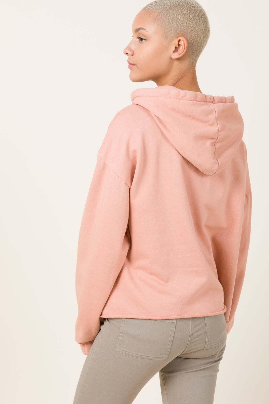 Our Band Together hoodie in Pink Guava is an oversized pullover hoodie with deconstructed hem and elasticated cuffs. Evocative of the 70's era home sewing, the smaller hood and oversized fit update this style.