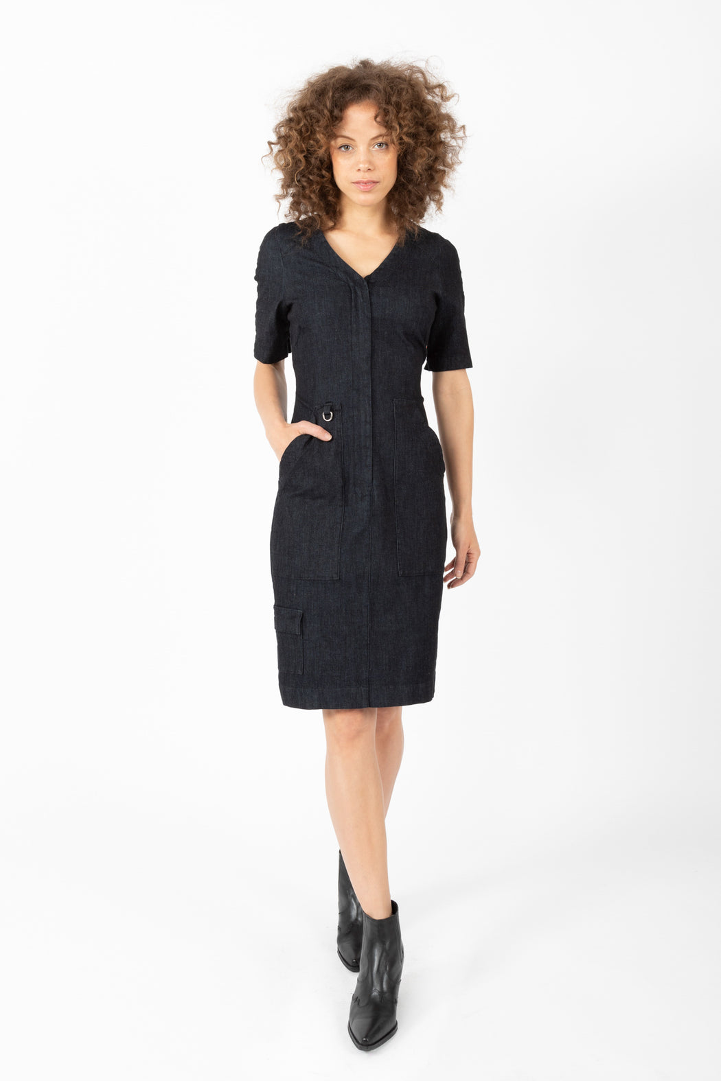 Our Faculty Dress is a high stretch denim dress with strategically placed pockets, a hardware detail, and short sleeves offer seasonal versatility.