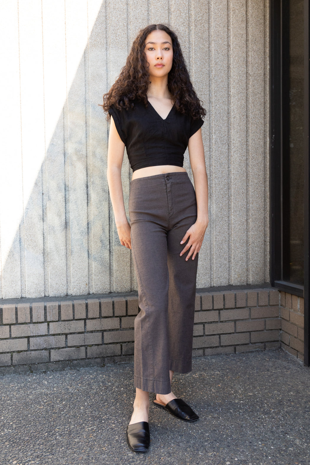 Photo of a high-rise, cropped, gray denim culottes made with high stretch twill.