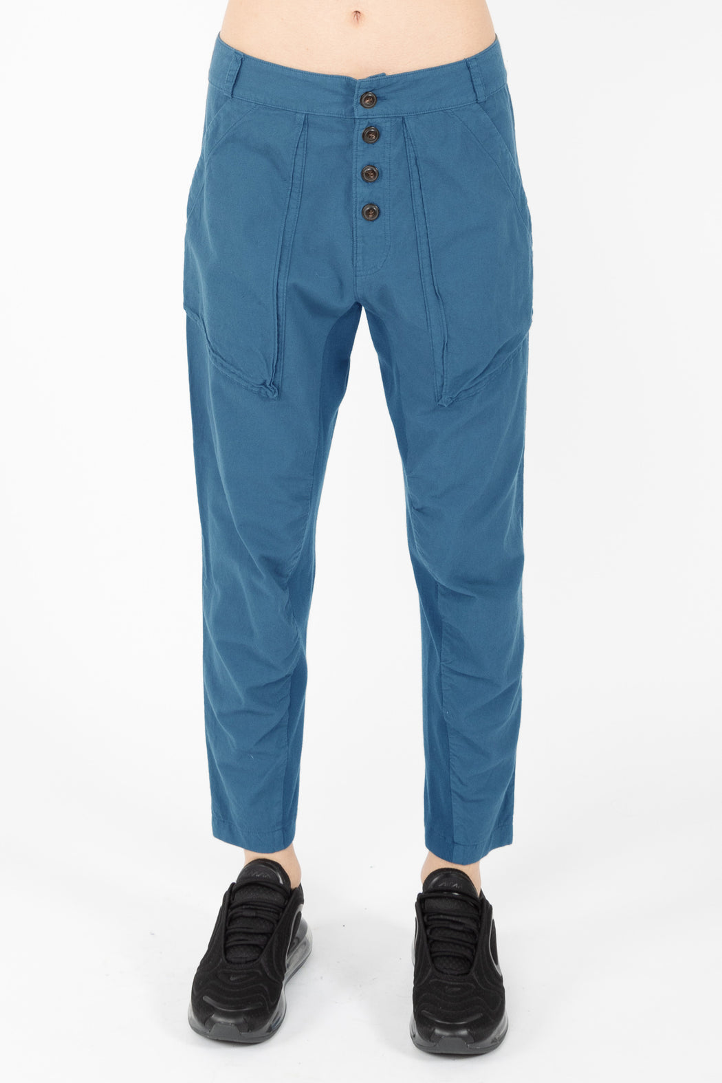 An incredibly soft, relaxed, lightweight pant with an organic cotton muslin body has an organic cotton knit inset at the inseam for style and comfort. A mid-rise, exposed button fly pant with deep gusseted front pockets, back patch pockets and belt loops.The softened cotton will loosen with wear, the initial fit should be snug.