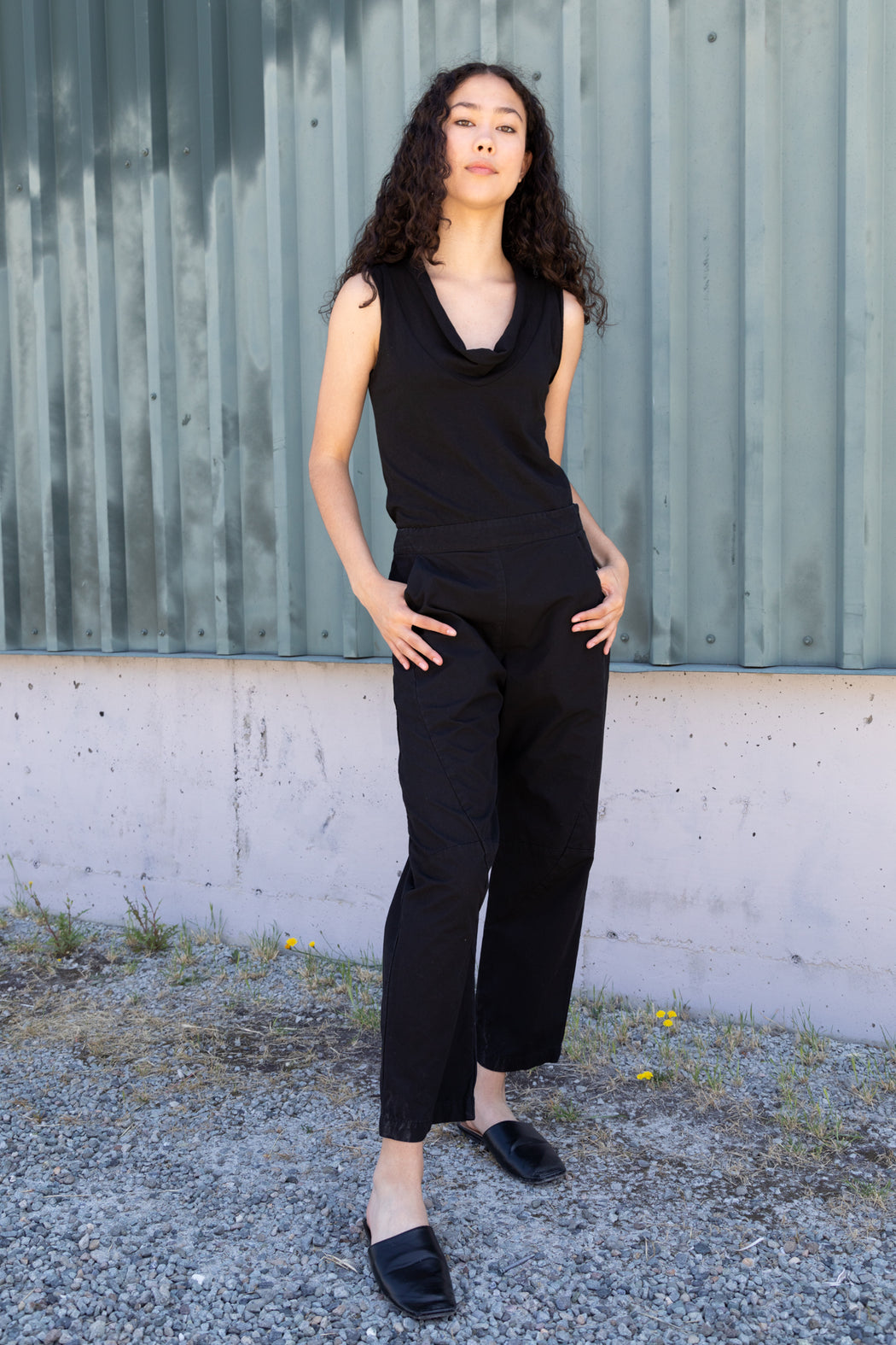 Photo of a lightweight, scoop, cowl neck t-shirt composed of 100% organic cotton jersey in black.