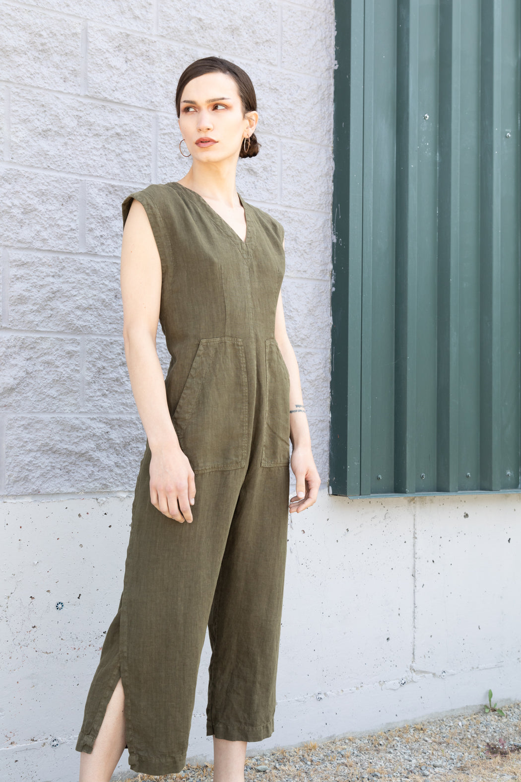Photo of an army green linen jumpsuit with ties for adjustable wearing and sizing.