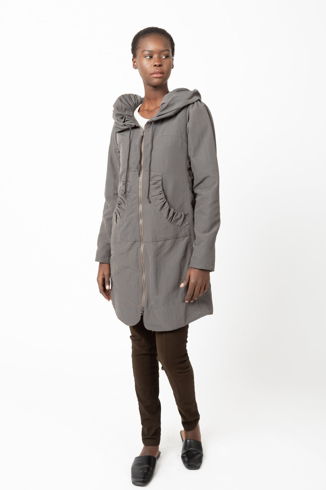 Our best-selling Long Cloak Hoodie reinvented in a Victorian style Raincoat with exaggerated hood and soft cotton lining.