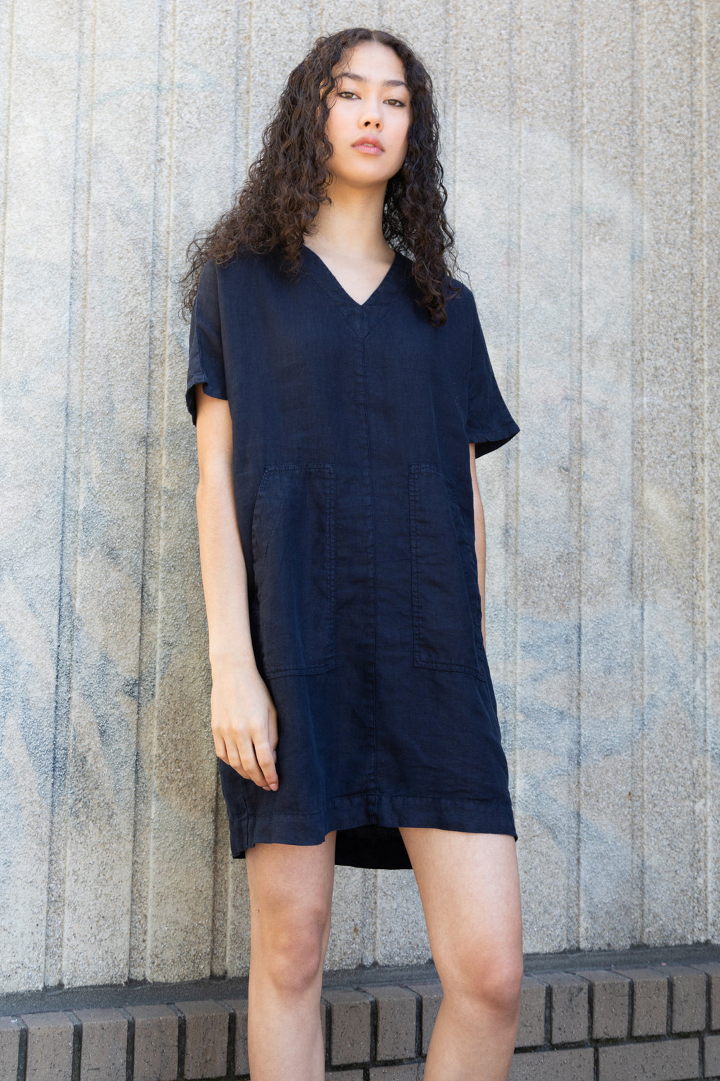 Photo of a 100% linen dress with short sleeves and large front patch pockets.