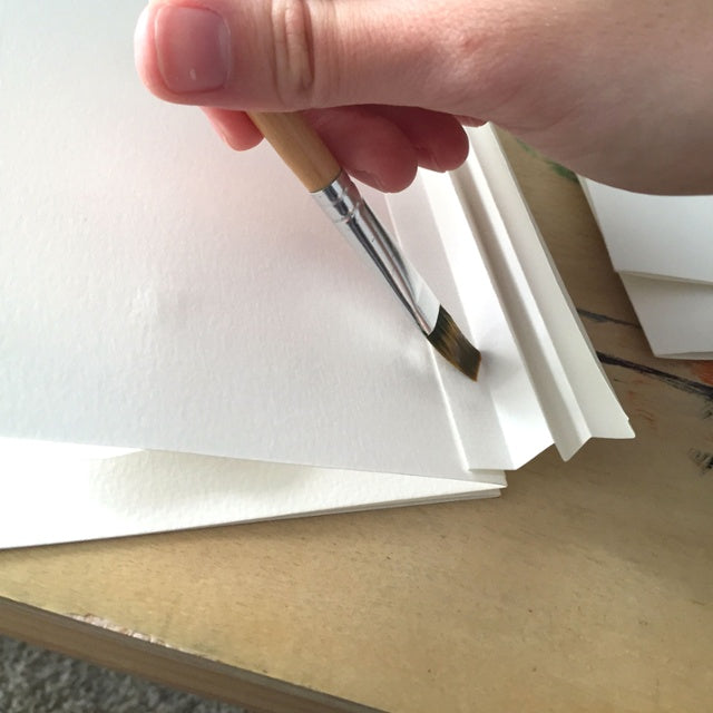 Add glue to paper book spine