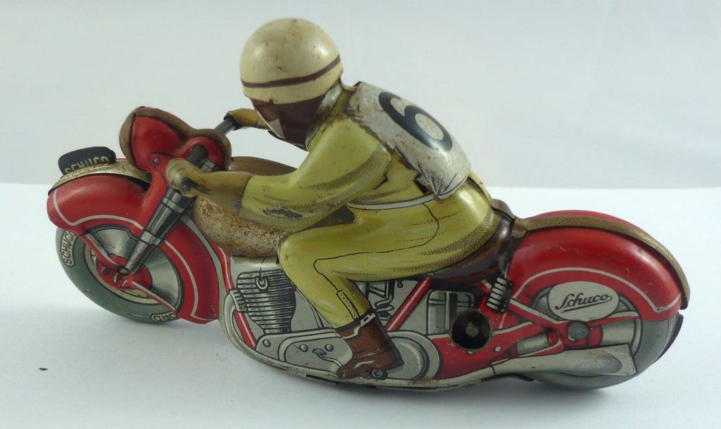 Original Schuco clockwork tinplate Motodrill motorbike and rider