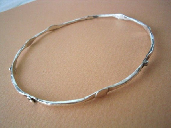 Thin Sterling Silver Stacking Bracelet.
