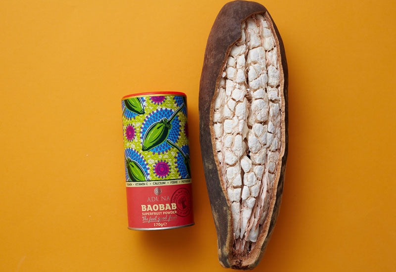 Aduna Baobab Fruit Powder and an opened baobab fruit