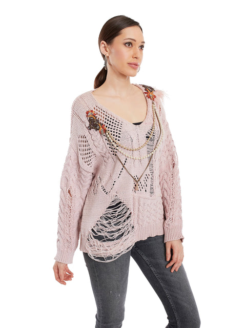 Distressed knit with broach detailing