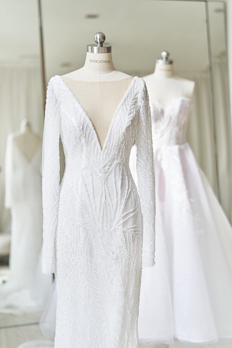 Beaded long sleeve wedding gown