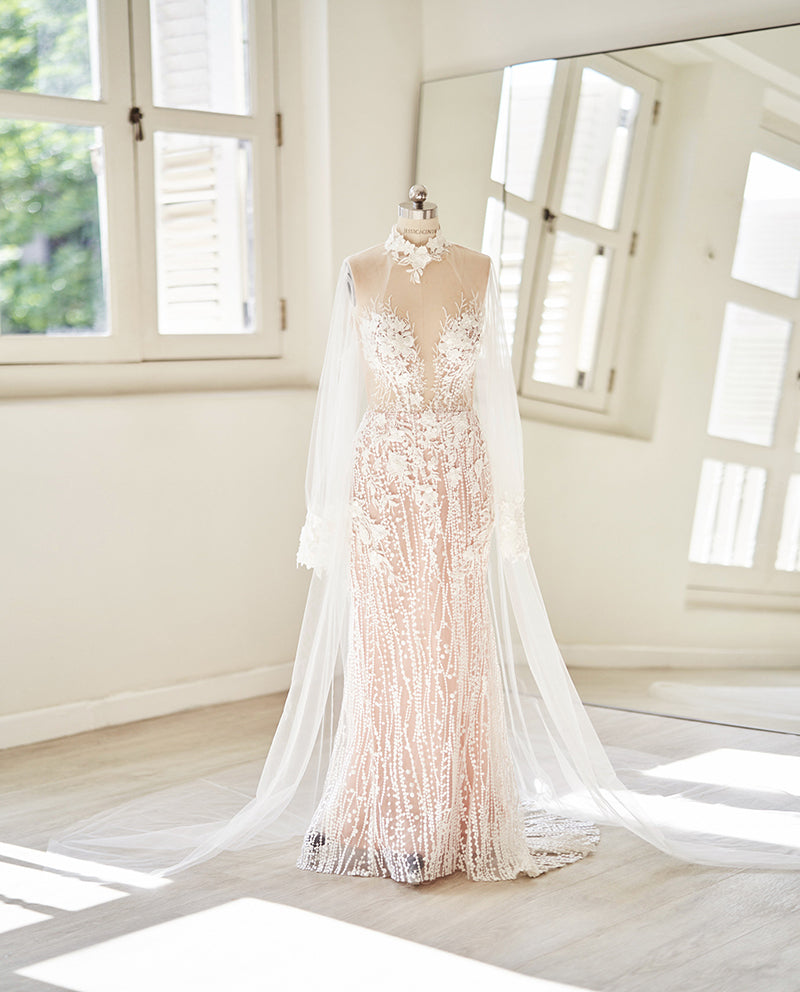 Lace wedding gown with illusion neckline