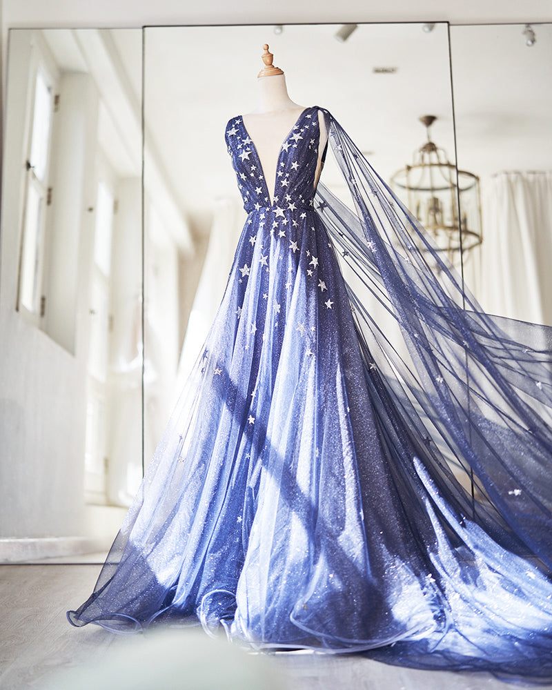 Blue evening gown with stars applique