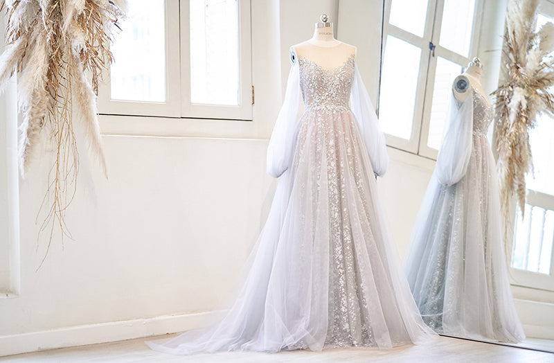 Grey evening gown with puff sleeves and glitter