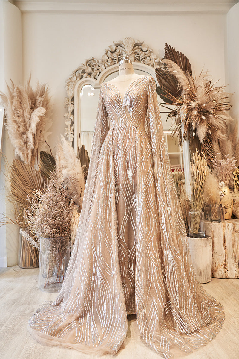 Gold evening gown with cape