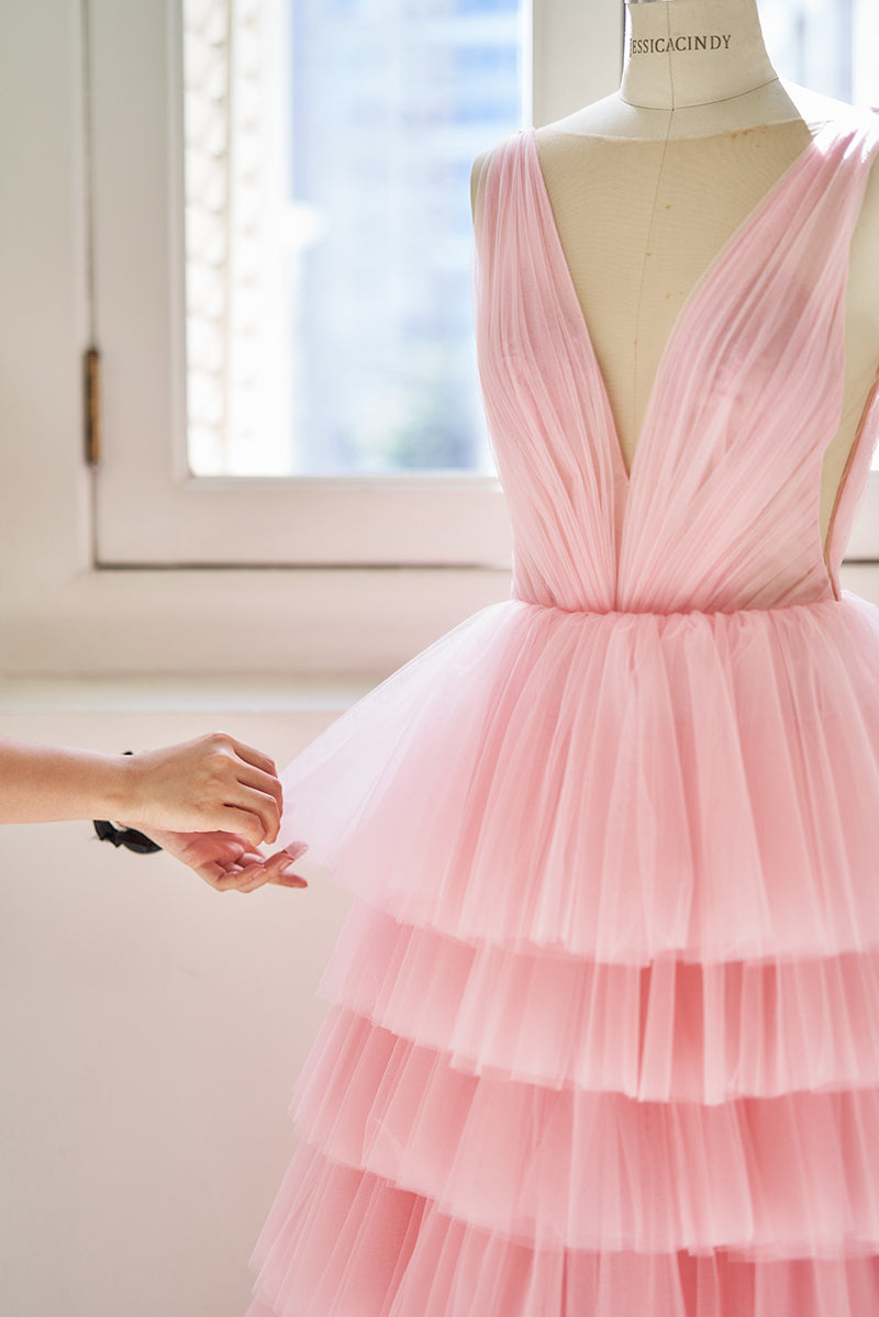 Light pink tiered evening gown