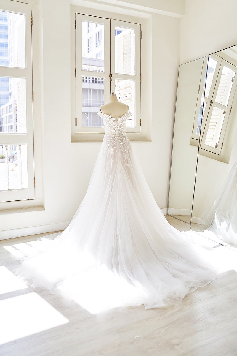 Wedding gown with off shoulder sleeves