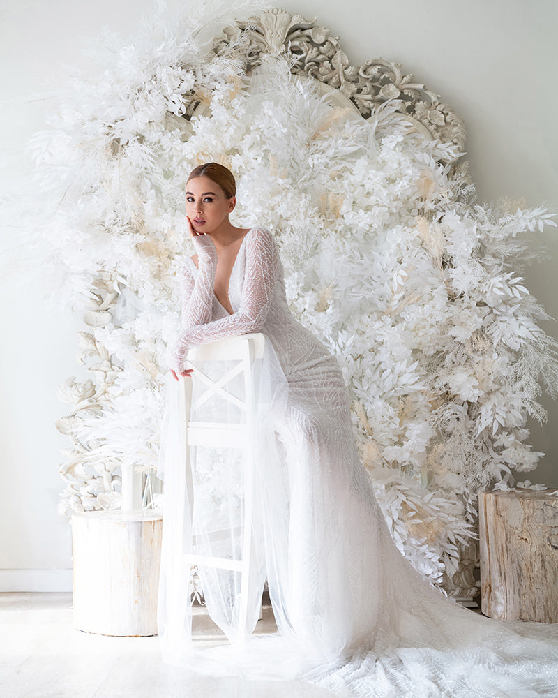 Yvette King in beaded long sleeve wedding gown