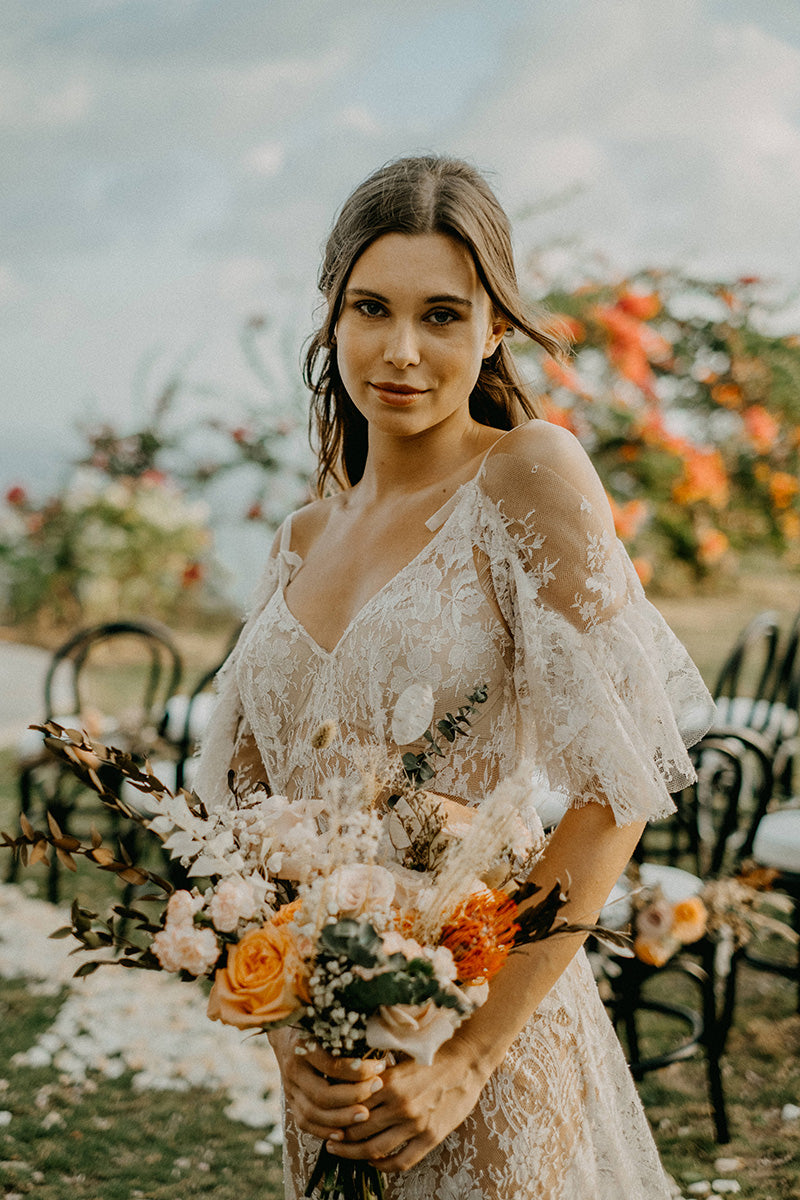 Bohemian lace wedding dress with off shoulder sleeves