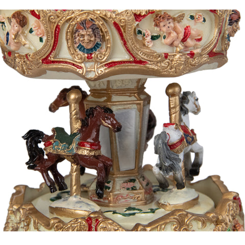 6.5 Ivory and Gold Animated Musical Clown and Cupid Carousel Tabletop Decoration