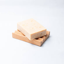 Load image into Gallery viewer, turmeric soap bar on soap block