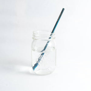 blue stainless steel reusable straw in a mason jar
