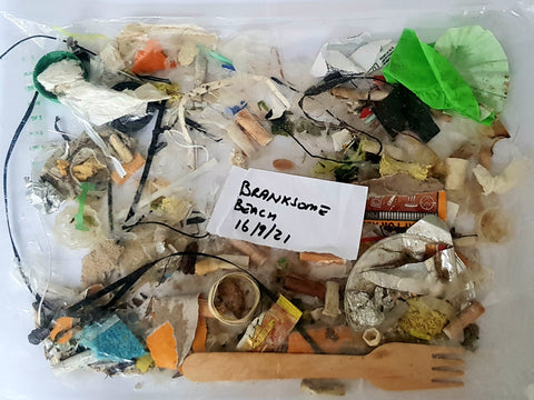 Rubbish and Plastics found under the surface of the sand