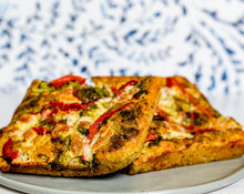 Load image into Gallery viewer, Focaccia with Basil Pesto, Fresh Mozzarella, Roasted Red Peppers, and Parmesan Cheese