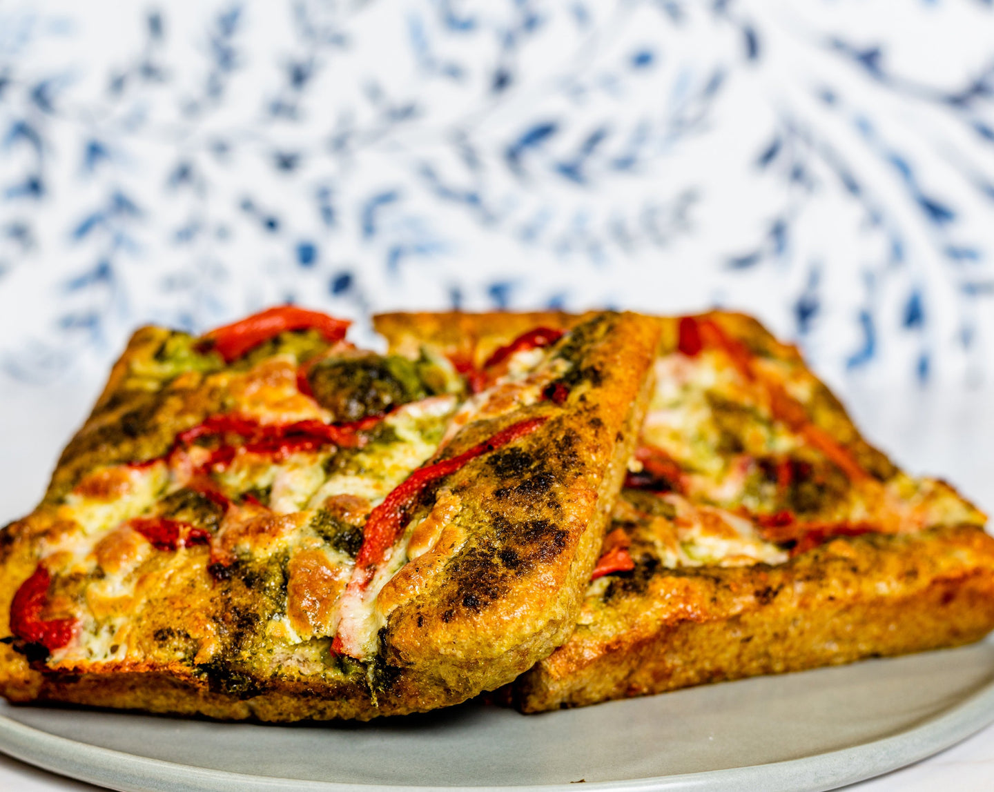 Focaccia with Basil Pesto, Fresh Mozzarella, Roasted Red Peppers, and Parmesan Cheese