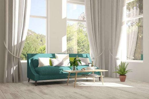 living room sun shine in bright through curtained windows on a sofa