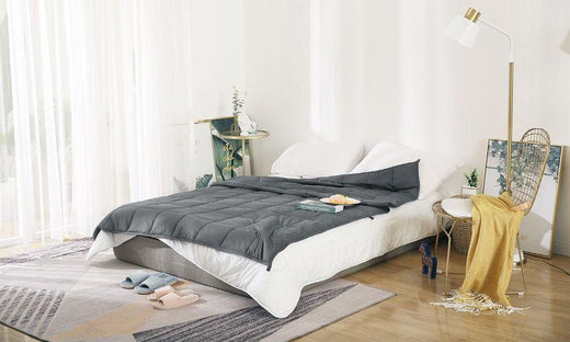 weighted blanket on a white bed
