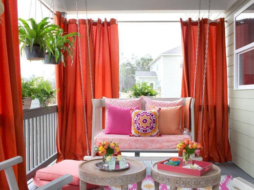 lovely balcony with sofa curtains and view out the window