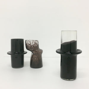 Clear and Solid Black Pipe Vessel
