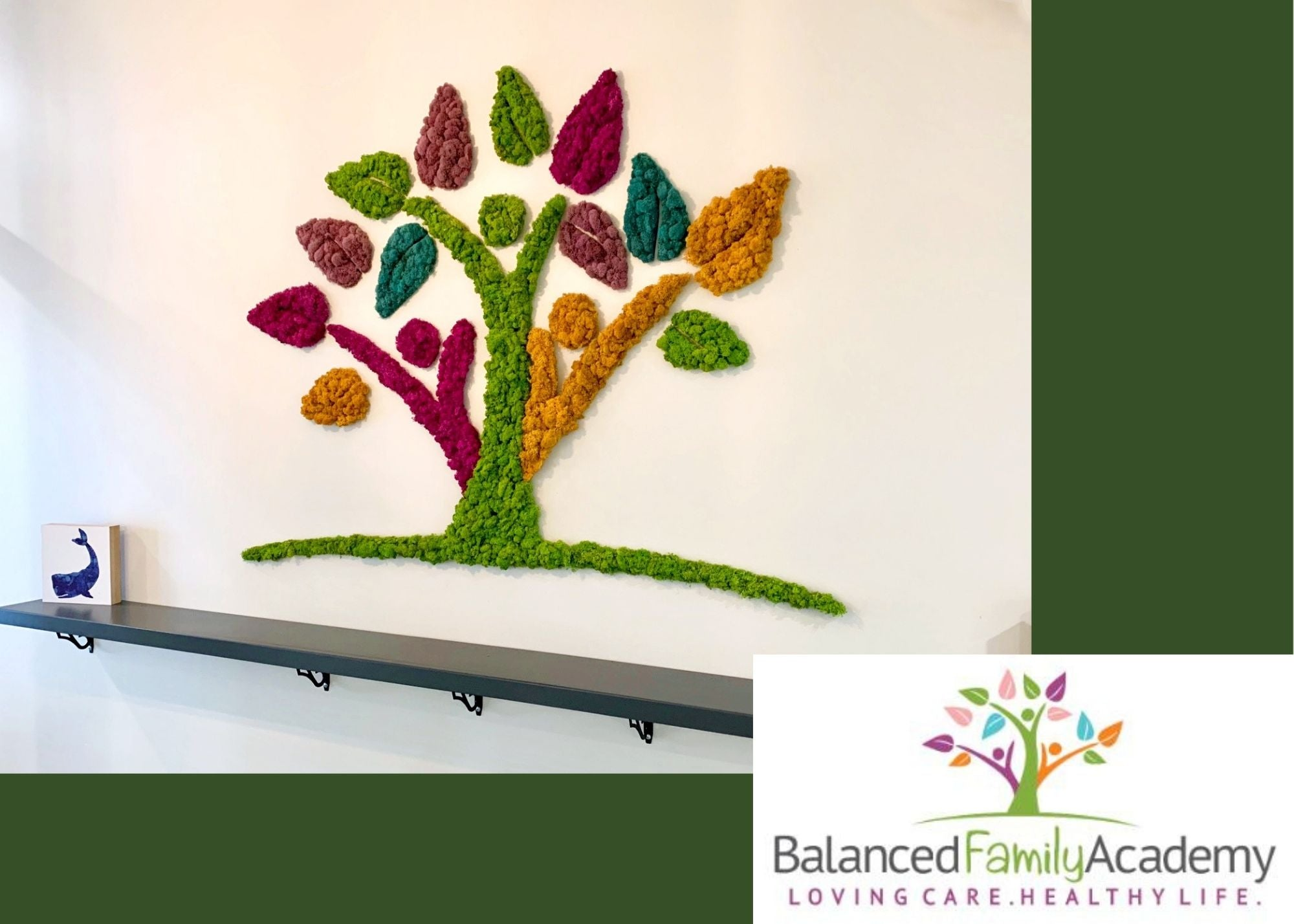 Custom moss wall recreating a daycare logo of a colorful tree using multiple colored moss. Moss art by Oakland Green Interiors.