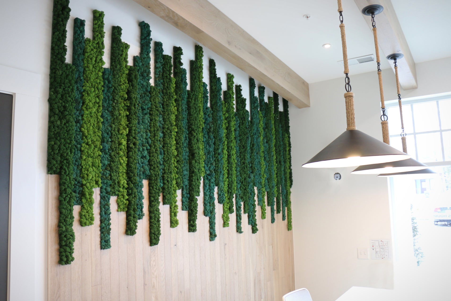 Custom moss art with alternating vertical stripes of assorted colors of moss. Moss art by Oakland Green Interiors in Columbus, Ohio.