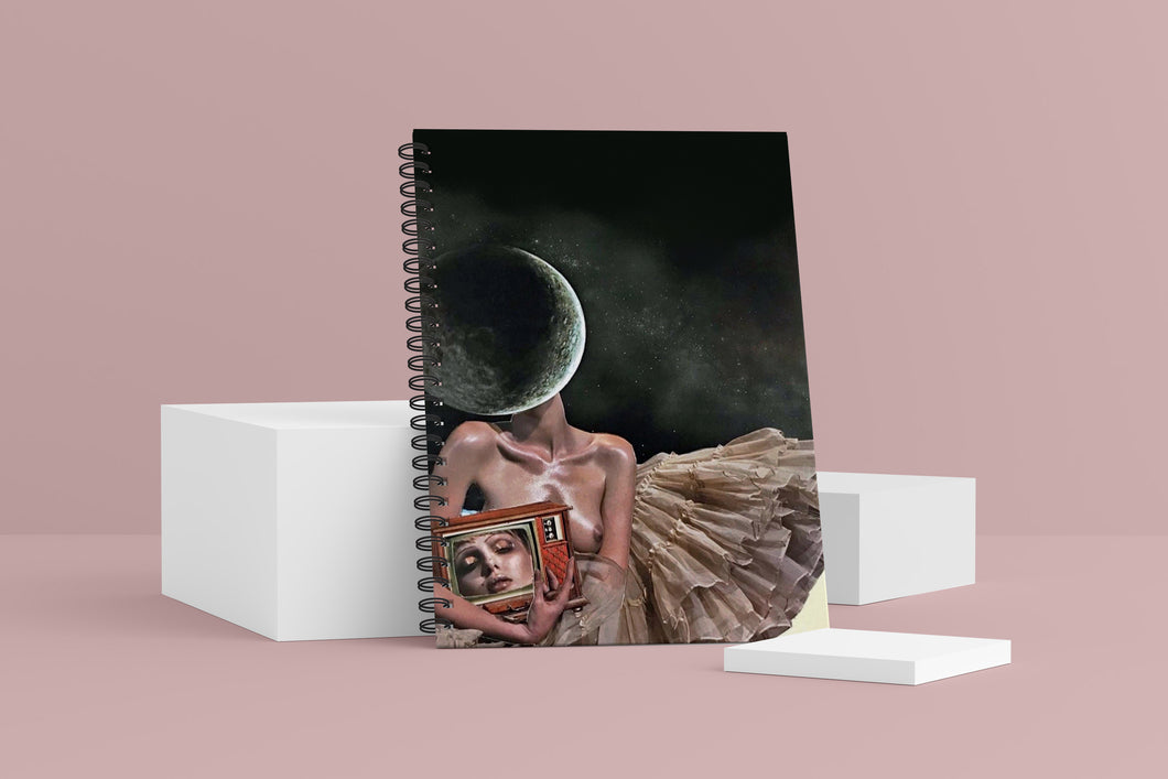 Homebound Wellness Journal. The cover shows a collage featuring a woman with a moon for a head, wearing a tutu, holding a television with her head in it.
