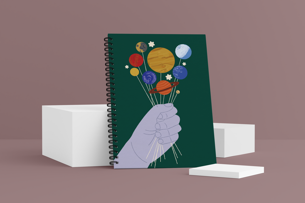 Give You the Galaxy Wellness Journal. Cover shows a blue hand holding planets like lollipops