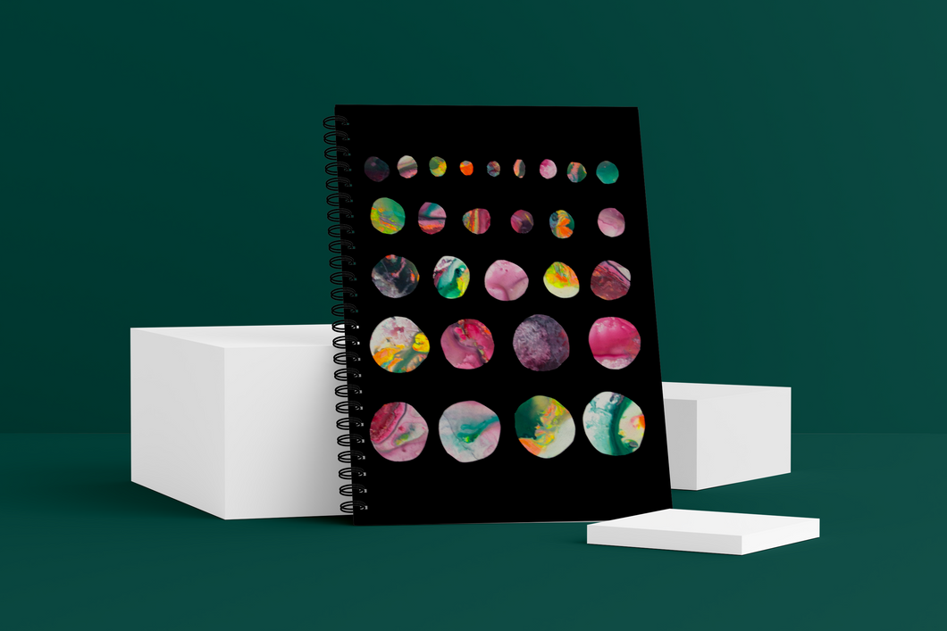 Moons Wellness Journal. The cover shows marble-like moons getting larger row by row