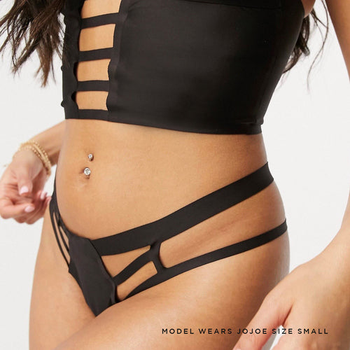 Stylish and contemporary black caged thong made from super soft and comfortable recycled materials