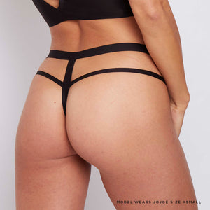 This black caged thong is made with hi tech bonded seams and printed care labels to reduce wastage and the environmental effect.